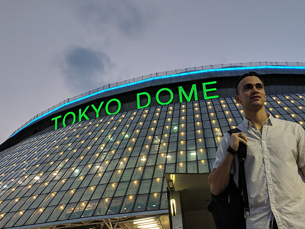 A student stands in front of the Tokyo Dome