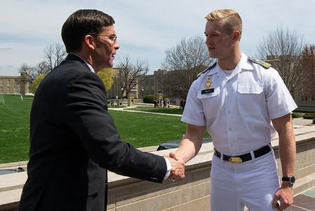 A man is shaking hands with a cadet