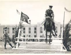 Cavalry cadet going over jump