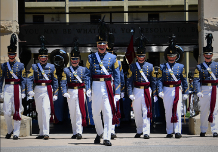 Photo of cadets marching in line in full uniform.