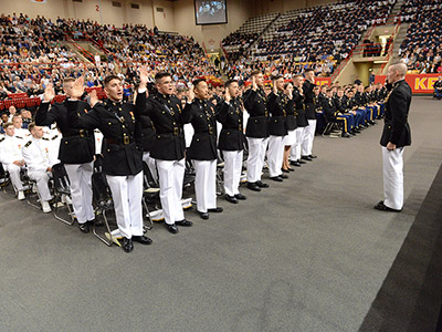 Cadets entering the U.S. Marine Corps stand to take the oath.
