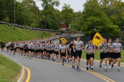 Cadets run down Saunders Drive during the 9/11 memorial group run.