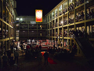 Members of VMI's club boxing team trade blows Nov. 11 in a ring set up in New Barracks Courtyard surrounded by cadets cheering from the courtyard and the stoops. – VMI Photo by Stephen Hanes.