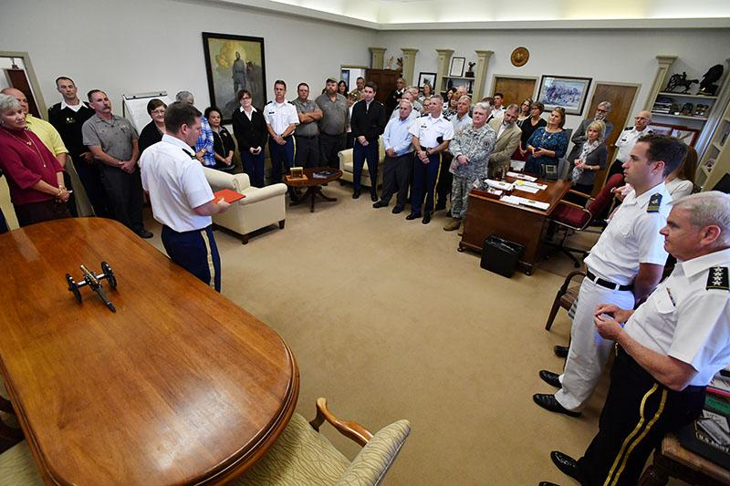 Dallas Clark '99 speaks to friends from across post after receiving the Meritorious Service Medal in October. – VMI File Photo by Stephen Hanes.