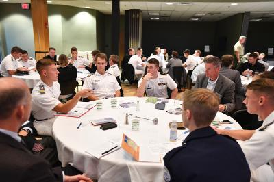 Cadets and visitors discuss the ethical implications of various scenarios at the ethical leadership challenge.