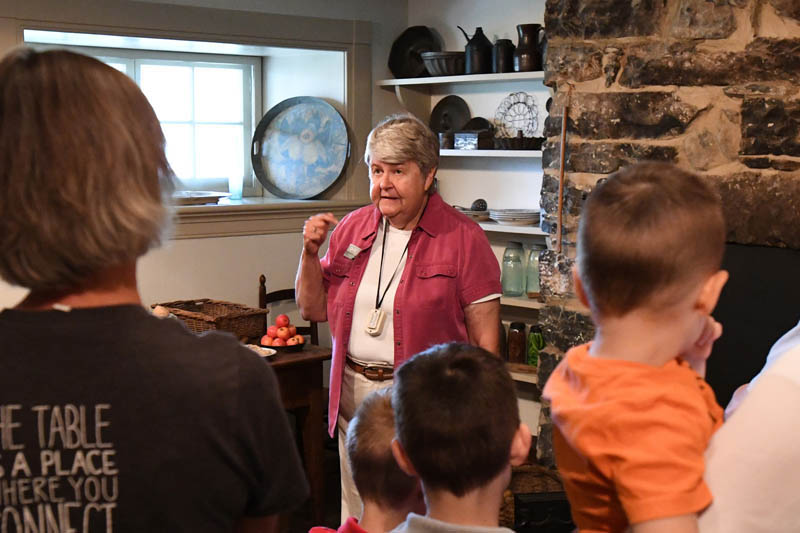 Tamara Teaff, a volunteer at the Stonewall Jackson House, leads visitors through Jackson's kitchen. – VMI File Photo by H. Lockwood McLaughlin.