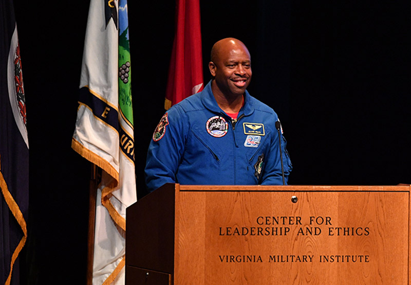 Astronaut Leland Melvin speaks from the podium in Gillis Theatre.