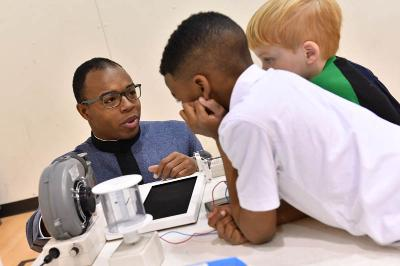 National Society of Black Engineers cadets visit Central Elementary School.