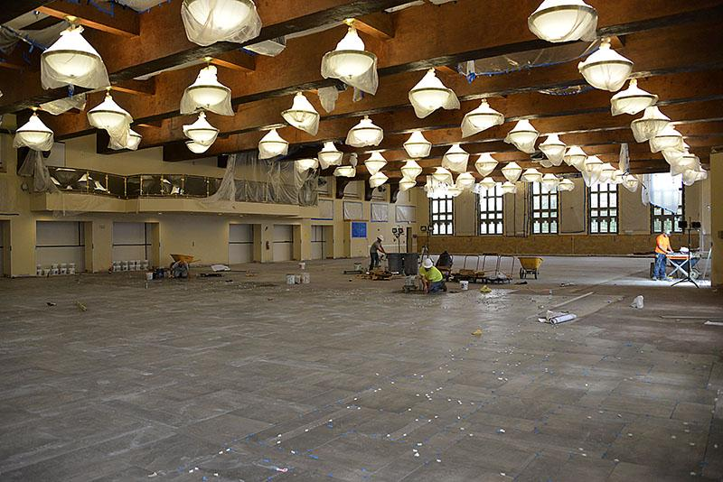 Contractors work in Crozet Hall, the Institute's main dining facility.