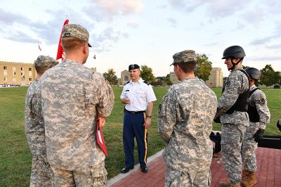 Col. Tom Timmes '92 speaks with cadets just before firing the evening gun in his role as Officer in Charge.