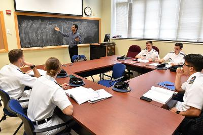 Cadets look on as their professor teaches Arabic.