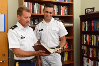 Jacob Van Dyke '19 confers with Lt. Col. Spencer Bakich about his thesis for the national security minor.—VMI Photo by Mary Price.