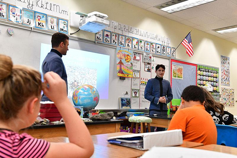 Brandon Campbell '20 and Christian Vaccaro '19 talk to 5th graders about ocean plastic.
