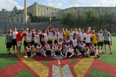 The club lacrosse players pose on the north post turf field.