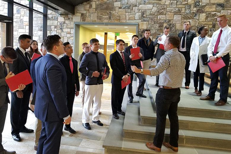 Richard Luck '12 leads a tour through Luck Industries during the e-Club's trip to Richmond.—Photo Courtesy of Dr. Dee Mornah.