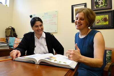 Mary Beth Manjerovic and Janice Friend discuss possible changes to the biology curriculum.