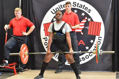Cadet Holly Njabo '20 deadlifts during the powerlifting competition in Cocke Hall.