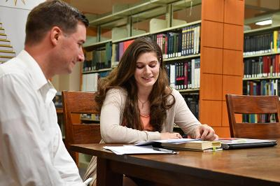 Maj. Steve Knepper and Maddy Moger '20 discuss her research on fairy tales.—VMI Photo by Mary Price.