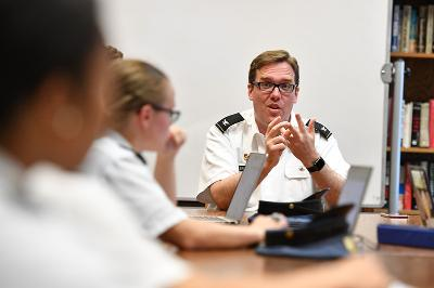 Col. Howard Sanborn sits with cadets in Scott Shipp Hall.