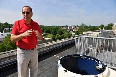 Col. Greg Topasna shows off the new solar telescope dome installed atop Maury-Brooke Hall.