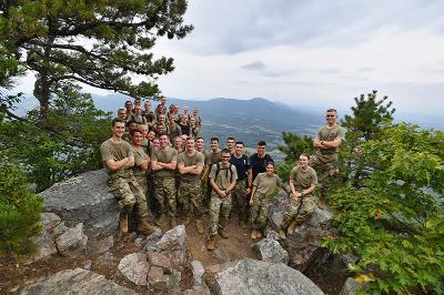 New cadets pose for a photo atop House Mountain.
