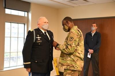 Maj. Gen. Cedric T. Wins, interim superintendent, pins a VMI Meritorious Service Medal on Eric Hutchings, recognizing his service to the Institute upon his retirement. - VMI Photo by Kelly Nye.