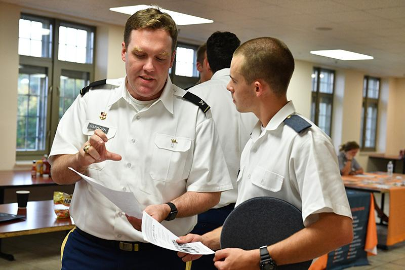 Col. Howard Sanborn, professor of international studies, talks with a cadet during the study abroad fair Sept. 20.—VMI Photo by Kelly Nye.